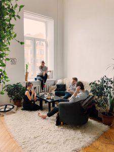 people gathered inside house sitting on sofa 1054974  fertighausbewertung